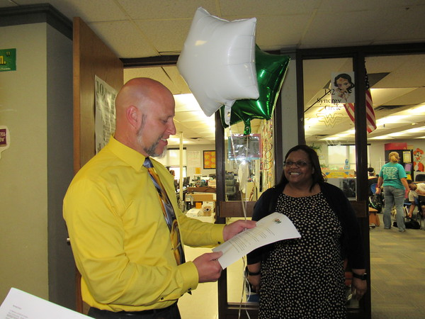 Staff photo by Cathy Spaulding<br /> Ben Franklin Science Academy teacher Mark Colvin looks at his notification of an $1,855 grant from the Education Foundation of Muskogee while Muskogee Public Schools Elementary Education Director Clevetta Gray watches.