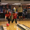 Staff photo by Harrison Grimwood<br /> D.J. Robbins, 6, coaches his mother, Sherri Graham, on how to bowl a perfect game at the Junior Achievement Super Hero Bowl on Thursday at Green Country Lanes.