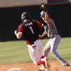 Special photo by John Hasler<br /> Hilldale's Aaron Sanders beats the tag by Checotah shortstop Korbin King at second base in the Class 4A district playoff Thursday at Hilldale.