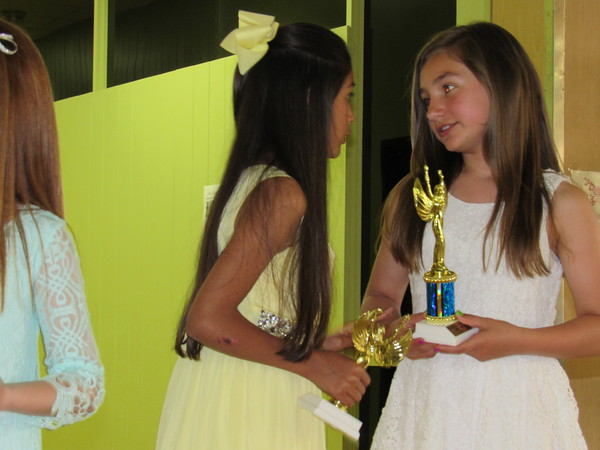 Staff photo by Cathy Spaulding<br /> Grant Foreman Elementary students Celeste Lira, left, and Makayla Vaughn chat after receiving trophies in the Third and Fourth Grade Poster Contest.