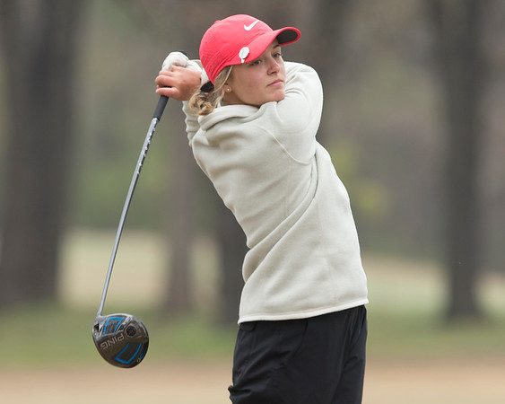VON CASTOR/Phoenix special photo<br /> Hilldale's Jordan Clayborn tees off on the par-4 14th hole Monday afternoon at the Muskogee Country Club in the Hilldale Invitational golf tournament. Clayborn took medalist honors with an even-par 72 as the Lady Hornets won the tournament by 50 strokes.