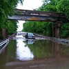Staff photo by Wendy Burton<br /> A truck remains after flood waters receded under a railroad bridge on Oklahoma 10 near Willey Road in Fort Gibson on Saturday. Emergency responders reported the occupant was able to escape on their own, though the truck was overwhelmed with water up to the roof before it receded.