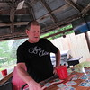 Staff photo by Cathy Spaulding<br /> Jay Huffer shows some baseball cards he has laminated on a backyard bar counter. He made the counter himself.