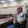 CATHY SPAULDING/Muskogee Phoenix<br /> Michael Sharpe sits in his Board of Trustees seat at Town Hall. He was recently appointed Fort Gibson<br /> mayor.