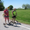 CATHY SPAULDING/Muskogee Phoenix<br /> Keli Glover and Jim Glover take their dogs Hannah and June for a walk around the Fort Gibson Historic Site. Warm skies on Friday offered ideal weather for people and pets to go outside.