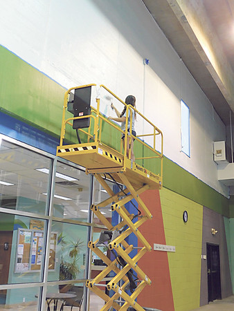 CATHY SPAULDING/Muskogee Phoenix<br /> Muskogee Swim & Fitness Center Aquatics Supervisor Bailey Arnold paints the center's swimming area wall in preparation to re-open Friday. The center was closed in March in response to the COVID-19 pandemic.