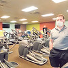 CATHY SPAULDING/Muskogee Phoenix <br /> Muskogee Swim & Fitness Manager Kevin Anthis says signs have been put on every other treadmill and cardio unit to ensure 6 feet of distance when Muskogee Swim & Fitness reopens on Friday.