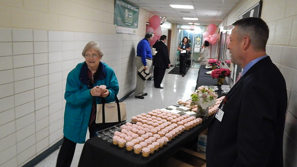 Staff photo by Mark Hughes<br /> Payroll coordinator Nancy Clark walks off with a cupcake Monday morning as she prepares to go to work. Promotional Saint Francis Hospital Muskogee bags were also handed out to employees. EASTAR Health System became Saint Francis Hospital Muskogee on Saturday.