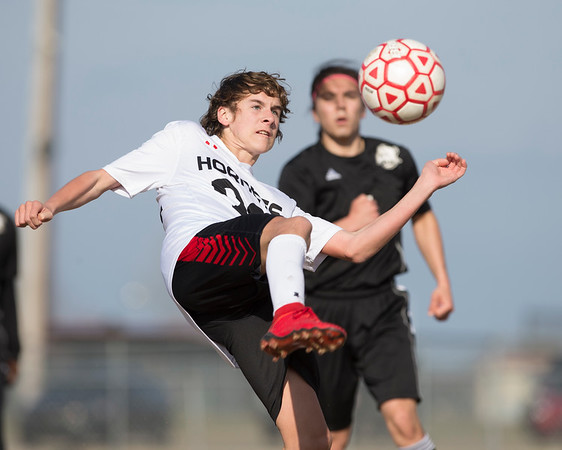 VON CASTOR/Phoenix special photo<br /> Hilldale's Corbet Weaver takes a shot on goal Tuesday afternoon against Hugo at Hilldale.