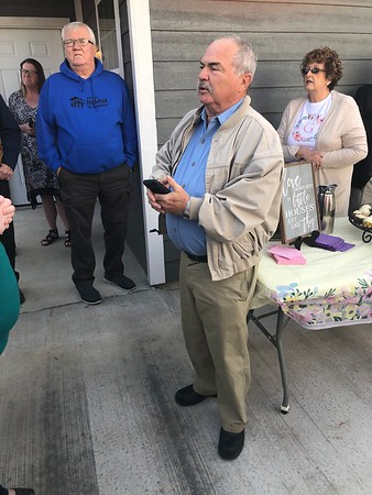 Habitat for Humanity Muskogee volunteer Tony LaBounty thanks his fellow volunteers while celebrating the completion of the group's 37th home.