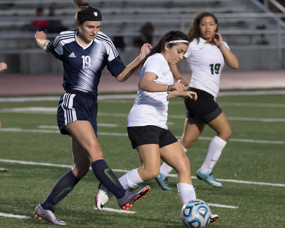 Phoenix special photo by Shane Keeter<br /> Muskogee's Kimberly Acevedo, center, steals the ball from Ponca City's Destiny Crowder as Acevedo's teammate Journey Jaquez, right, looks for a pass during Tuesday's game on Creek Nation Field at Indian Bowl.