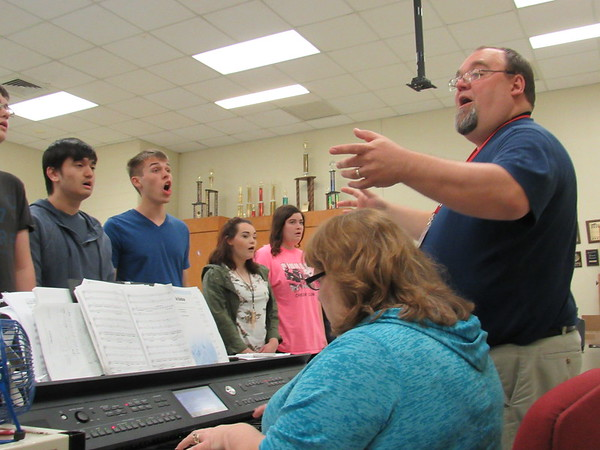 """Staff photo by Cathy Spaulding<br /> Hilldale Choir Director David Smith leads choir members in """"Danny Boy"""" while Emily Wasson accompanies on the keyboard. The choir will join in a """"Night of the Arts"""" Thursday at the gym."""