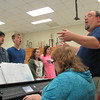 "Staff photo by Cathy Spaulding<br /> Hilldale Choir Director David Smith leads choir members in ""Danny Boy"" while Emily Wasson accompanies on the keyboard. The choir will join in a ""Night of the Arts"" Thursday at the gym."