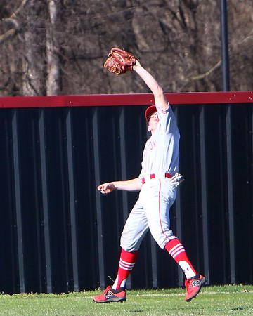 JOHN HASLER/Phoenix special photo<br /> Fort Gibson's Jace Dortch makes a grab in a recent contest against Wagoner. The Tigers are riding an 11-game win streak after an 0-3 start.