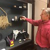 CHESLEY OXENDINE/Muskogee Phoenix<br /> Five Civilized Tribes Museum Director Sean Barney shows off some of the smaller pieces featured in this year's Art Under the Oaks competitive art show.