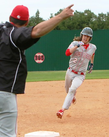 JOHN HASLER/Phoenix Special Photo<br /> Fort Gibson coach Matt Ross sends Andrew Rumbley<br /> home Thursday in the Tigers' win over Wagoner.