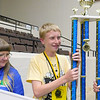 CATHY SPAULDING/Muskogee Phoenix <br /> Kyle Newell of Coweta holds the first place trophy after winning the Eastern Oklahoma State Spelling Bee on Friday. This is his third time to place in the Bee.