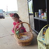 Staff photo by Mark Hughes<br /> Harper Duke, 2, unloads her food basket Friday at the Pantry on Peak in front of Boutique on Peak at 108 E. Peak Blvd. One of the things the pantry's creator, Jennifer Hollingshead, likes best is that children walking home from school can grab something to eat. She said their favorite was the canned Vienna Sausage. The pantry is open 24/7 and is available for anyone. Harper is the daughter of David and Kara Duke.