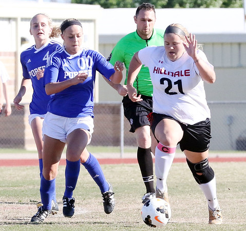 Phoenix special photo by John Hasler<br /> Hilldale's Gracie Farley dribbles downfield while challenged by Porter's Kennedy Mathis and trailed by the Lady Pirates' Carlee Boyd. The game ended in an 0-0 tie and went to penalty kicks, with Porter taking a 5-4 decision.