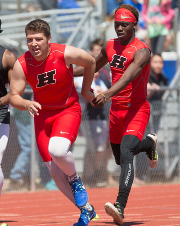Phoenix special photo by Von Castor<br /> Hilldale's Tre Mitchell, right, hands off to Alex Puckett during the boys 800-meter relay on Friday at the Hilldale Hornets Invitational track meet. The Hornets, relay team finished second in the event.