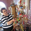 Staff photo by Cathy Spaulding<br /> Betty Honea shows Christmas ornaments that hang on a tree. Her home was on a Kelly B. Todd Cerebral Palsy and Neuro-muscular Center Christmas Home Tour about 15 years ago.