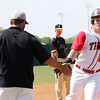 Phoenix special photo by John Hasler<br /> Fort Gibson Tiger Justin Garrett is congratulated by head coach Matt Ross after his solo home run Saturday.