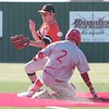 JOHN HASLER/Phoenix Special Photo<br /> Fort Gibson's Christian Jorgensen is safe on an errant Sperry throw at second Monday.