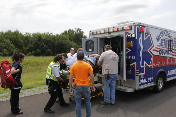 Staff photo by Harrison Grimwood<br /> First responders load the victim of a vehicle-pedestrian collision early Friday afternoon on U.S. 64 near Davis Field Road.