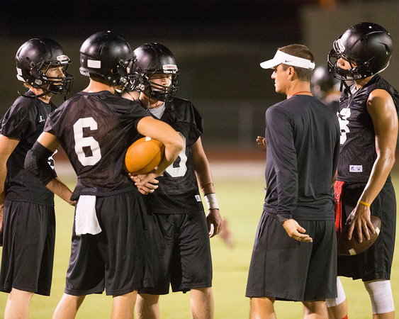 Special photo by Von Castor<br /> Tyler Goad, far left, Mitchell Croftcheck, left center, Kort Morgan, center, and Jaron Nail, far right, are intently listening to Hilldale coach Chad Kirkhart during Monday's first fall practice of the season. The Hornets were one of a few programs that began practice at 12:01 a.m.