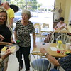 Staff photo by Harrison Grimwood<br /> Patty and Harold Langton receive congratulations from friends from around Oklahoma during their celebration of their 65th wedding anniversary Thursday afternoon at Chandler Road Donuts. The Langtons have visited the doughnut shop nearly daily for more than a decade.
