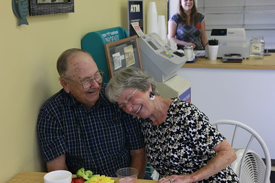 Staff photo by Harrison Grimwood Harold and Patty Langton share a laugh during their celebration of their 65th wedding anniversary Thursday afternoon at Chandler Road Donuts, where they have been steady patrons, coming in almost daily, for more than a decade.
