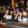 Special photo by Travis Sloat<br /> Alex Reynolds, right, the owner of Max's Garage, and employees and customers take a celebratory shot at 3 p.m. Sunday to commemorate the passage of a county ordinance allowing the sale of strong beer and liquor on Sundays.