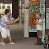 "Staff photo by Cathy Spaulding<br /> Fort Gibson Early Learning Center first-grade teacher Becky Roff takes a picture of one of her students, Brooklyn Stern, on Wednesday. Roff shot ""first day of school"" pictures of all her new students."