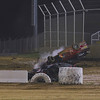 Special photo by Darren Stephens<br /> Robbie Gates from Homestead rolled his Outlaw Modified car down the front straightaway several times before coming to rest outside the track on the entrance to the pits during Friday's A feature at Outlaw Motor Speedway. Gates walked away from the accident, and Muskogee's Dalton Clay went on to win the feature.