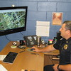 Staff photo by Cathy Spaulding<br /> Fort Gibson Police Chief Donnie Yarbrough uses a GPS system to keep track of police vehicles and other traffic. He became the police chief last spring.