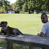 Staff photo by Harrison Grimwood<br /> Mark Cutshaw and his 7-year-old dog, Buster, take a break in the shade from their Monday afternoon walk in Spaulding Park. Temperatures reached the high 90s on Monday, but the heat index reached 105 degrees, according to AccuWeather.com.
