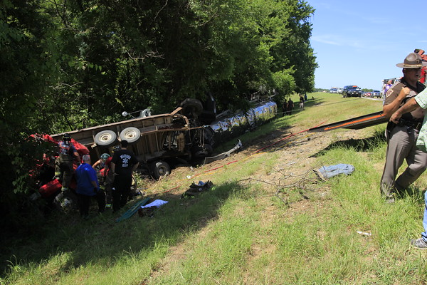 Staff photo by Harrison Grimwood<br /> Emergency responders work to untangle the wreckage of a tractor-tanker rig and a Ford F-350 on Thursday afternoon on U.S. 69 after a collision that killed the pickup's driver.