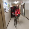 Staff photo by Cathy Spaulding<br /> Darla Bennett rolls her bicycle through Muskogee City Hall. When the weather's nice enough, she prefers commuting on two wheels.