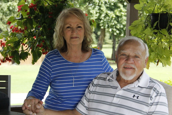 Staff photo by Harrison Grimwood<br /> Charles Raper and his wife, Sandy Raper, relax on their porch.