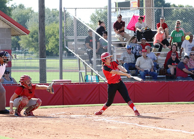 Special photo by John Hasler Hilldale's Kenzie Mize drives a ball over the wall in left center field for a three-run home run in the first inning of the Lady Hornets' game on Monday against Stilwell.