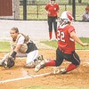 Special photo by John Hasler<br /> Fort Gibson's Aubree Bell, right, slides in safely ahead of the tag from Wagoner's Payton Stroud, left, while Bell's teammate Kelsey Hornback watches in the background during Monday's game in Wagoner.