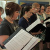 Staff photo by Cathy Spaulding<br /> Okiepella singers Peggy Harris, left, Laurie Havron, Meaghan McCawley, Kerry Huffer, Bert Luton, and Marsha Reynolds blend voices during rehearsal. Women and men in the a capella group will perform this weekend.