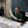 Staff photo by Cathy Spaulding<br /> Muskogee County Election Board Secretary Kelly Beach examines provisional ballots Friday.