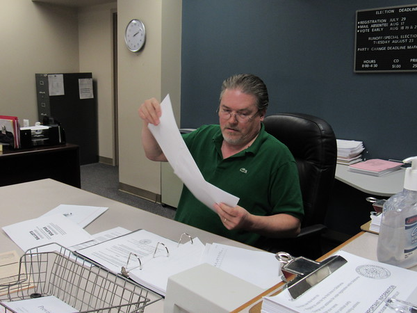 Staff photo by Cathy Spaulding Muskogee County Election Board Secretary Kelly Beach examines provisional ballots Friday.