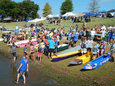 Staff photo by Mark Hughes Colorful boats made out of cardboard hug the beach at Three Forks Harbor on Saturday during the ninth annual River Rumba Regatta. Boat designs included the USS Oklahoma, a boat with a Chinese dragon head, and a paddlewheeler powered by a redesigned exercise cycle.
