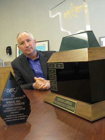 Staff photo by Cathy Spaulding<br /> Indian Capital Technology Center Superintendent Tony Pivec shows the Distinguished Achievement and Gold Star Awards ICTC received at the Oklahoma Career and Technology Education Summer Conference this week.