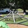 Staff photo by Cathy Spaulding<br /> Workers with Sooner State Steel Erectors assemble the top of a new gazebo for King Park. The gazebo could be completed by today. It is one of several improvements at King Park, at East Side Boulevard and Gibson Street. The park also boasts a new playground for kids, up to age 5. Muskogee Parks and Recreation Department also is adding gazebos at Bill Pool Park and Optimist Park.