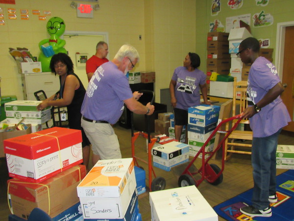 Staff photo by Cathy Spaulding<br /> Cherokee Elementary teachers fill their library with school supplies donated by the Facebook group Replenishing Oklahoma. The group also is donating supplies to Checotah, Webbers Falls, and Stidham schools.