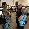 Staff photo by Mark Hughes<br /> Lori Jefferson, left, Cherokee Elementary School's principal, discusses school issues with Al and Sandy Stevens after Saturday's Community Police Action Board meeting at the Dr. Martin Luther King Jr. Community Center. The focus of the meeting was opportunities in Muskogee and Fort Gibson public schools to assist students and students with disabilities.