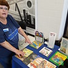 Staff photo by Mark Hughes<br /> Terry Beutelschies, outreach coordinator with United Way, talks about its program to provide children younger than 5 with an age-appropriate book each month.
